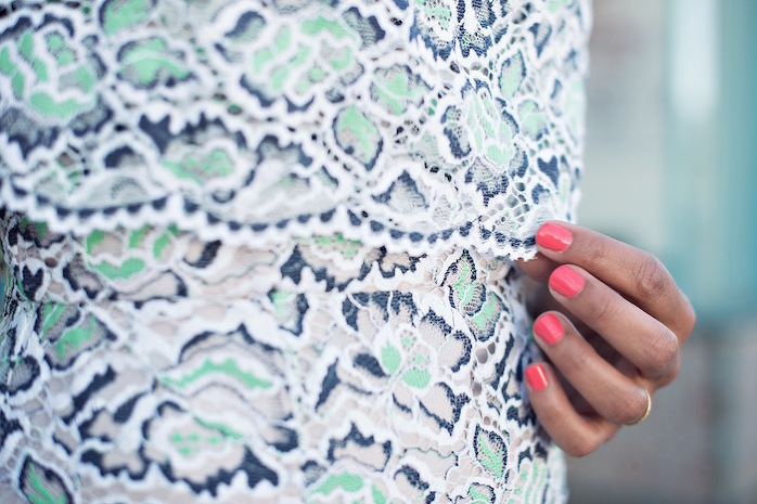 lace details with pink nails